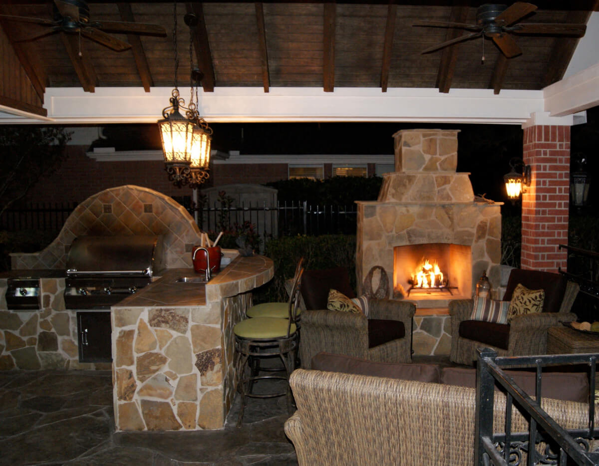 Gable Roof Patio with Outdoor Kitchen and Fireplace in Falcon Point