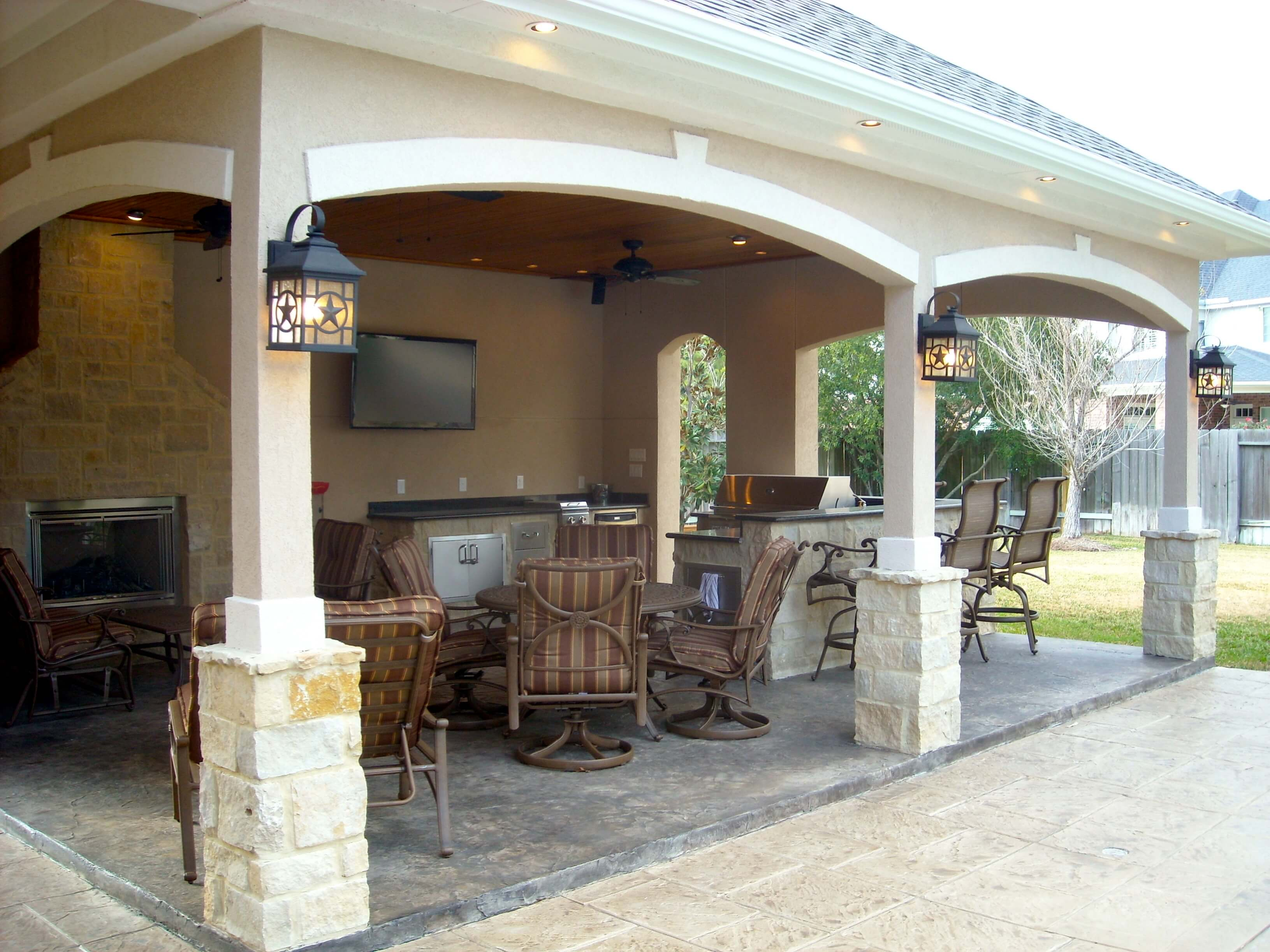 Pool house with outdoor kitchen fireplace in cypress for Pool with fireplace