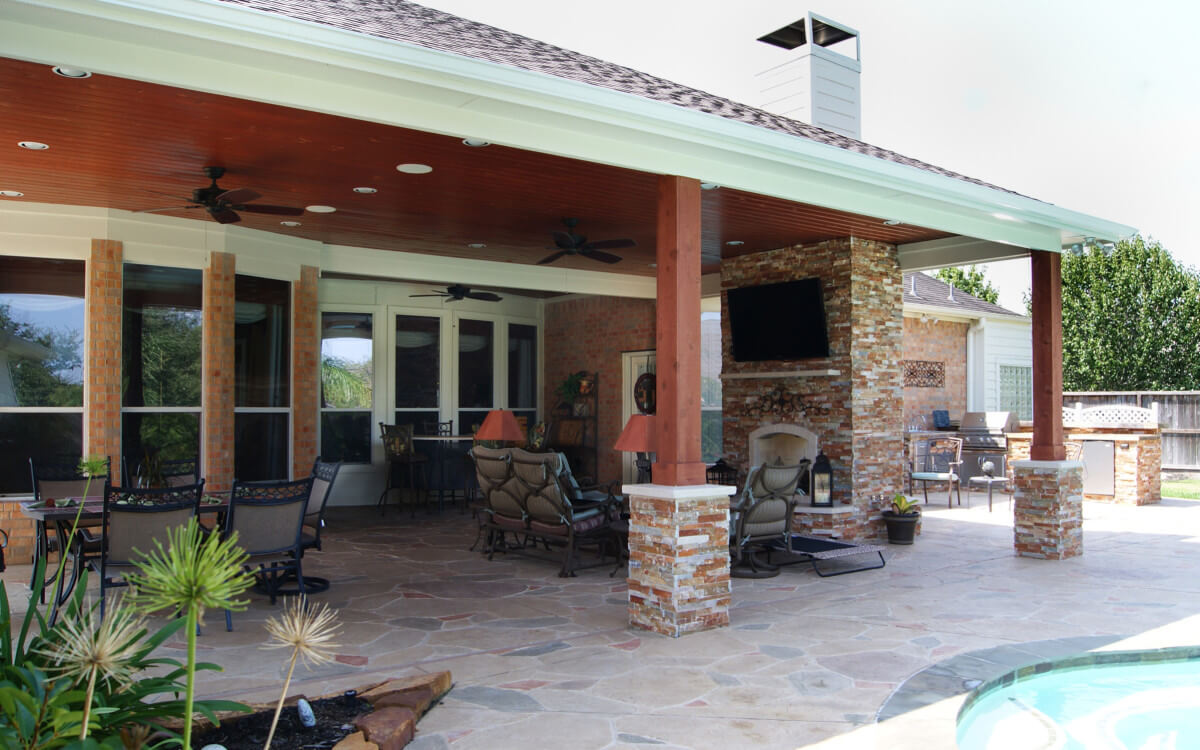 Cypress patio cover with fireplace and kitchen