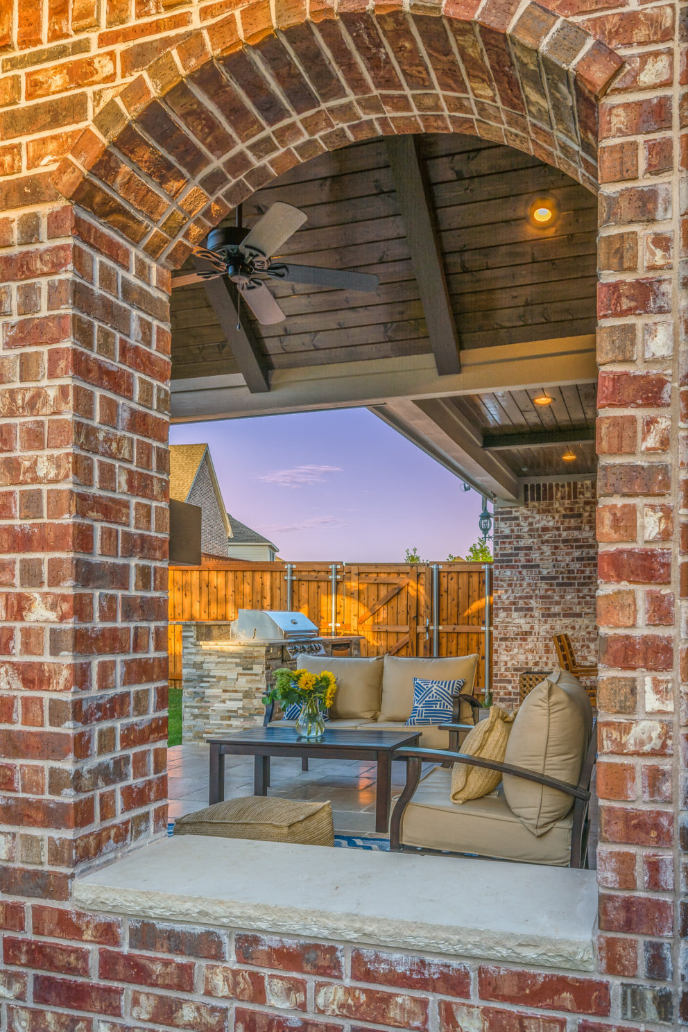 Arched brick wall on outdoor living space Allen