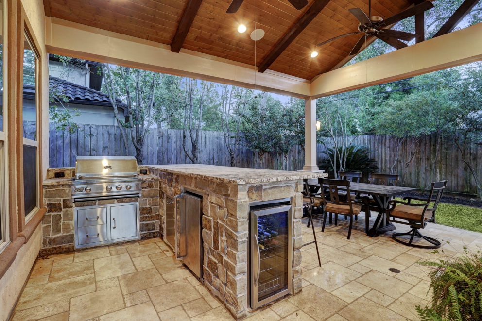 Outdoor kitchen with gabled roof patio cover